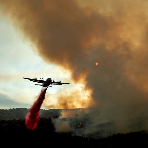 An air tanker drops retardant on the Ranch Fire, part of the Mendocino Complex Fire, burning near Clearlake Oaks, Calif., on Aug. 5, 2018. (Credit: NOAH BERGER/AFP/Getty Images)
