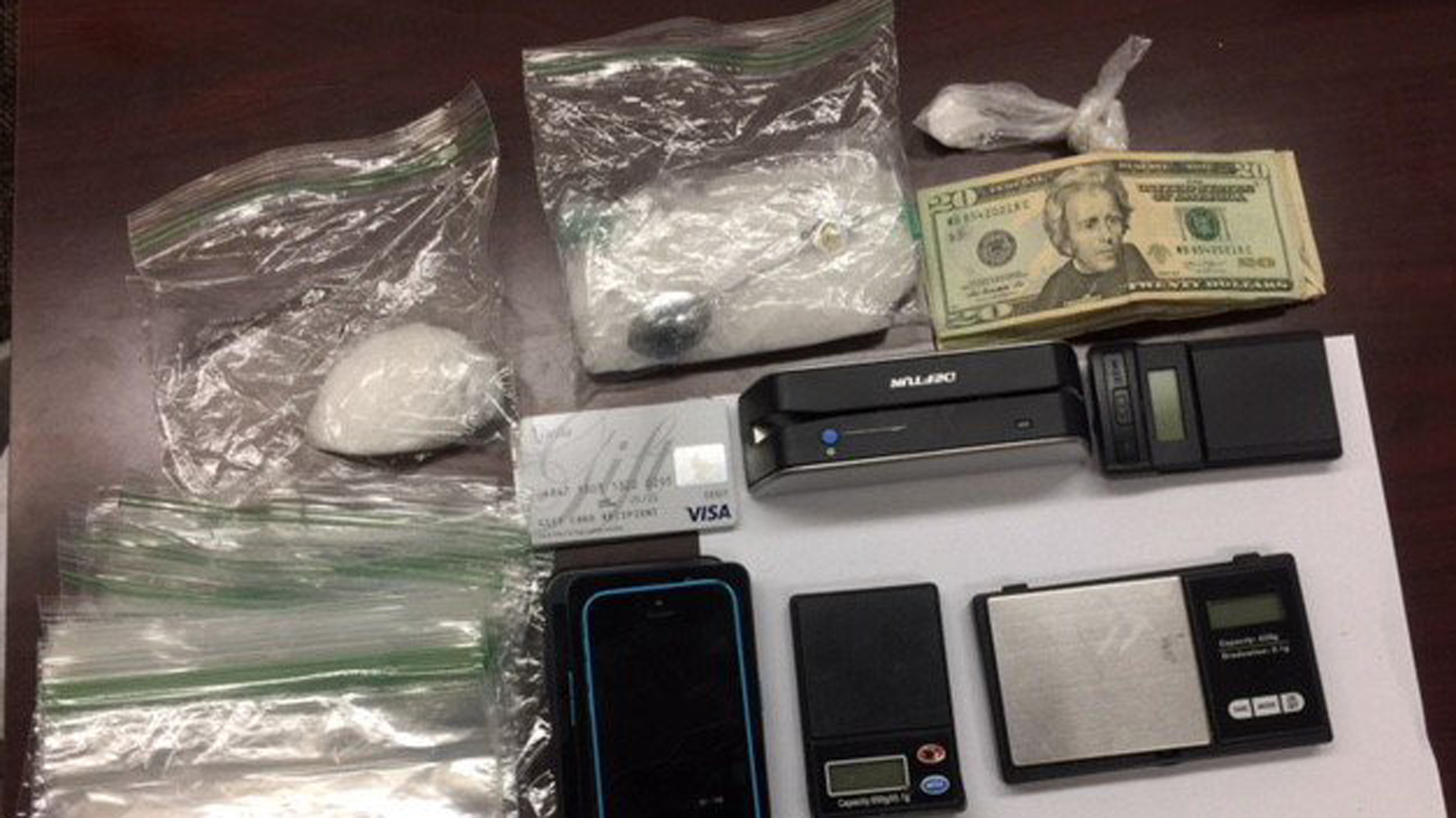 Deputies seized approximately half a pounds of methamphetamine, cash and ID theft equipment during a traffic stop in Norwalk on Aug. 15, 2018. (Credit: L.A. County Sheriff's Department)