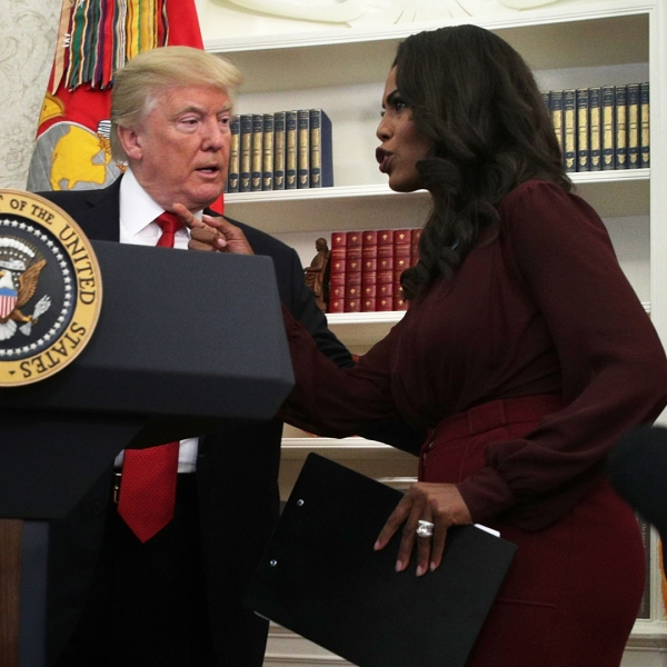 Donald Trump listens to Director of Communications for the White House Public Liaison Office Omarosa Manigault during an event in the Oval Office on Oct. 24, 2017. (Credit: Alex Wong/Getty Images)