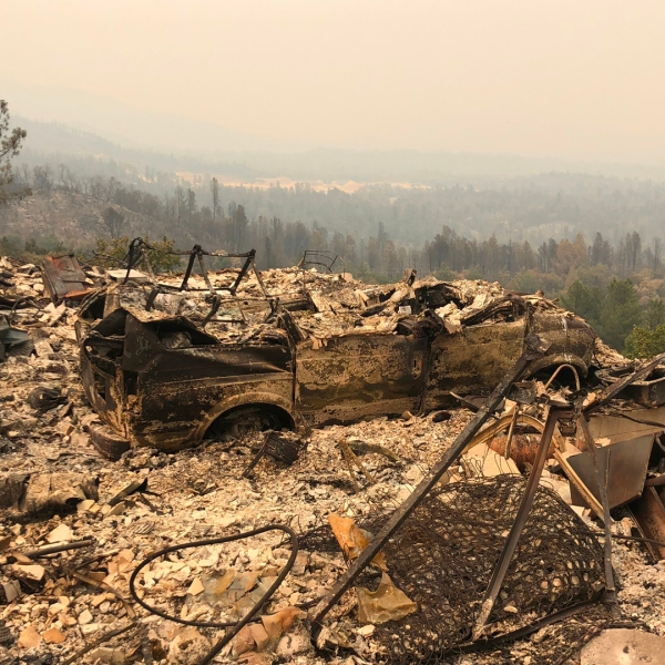 Rubble is seen in an area near Redding on July 29, 2018, after the destructive Carr Fire tore through area. (Credit: GIANRIGO MARLETTA/AFP/Getty Images)
