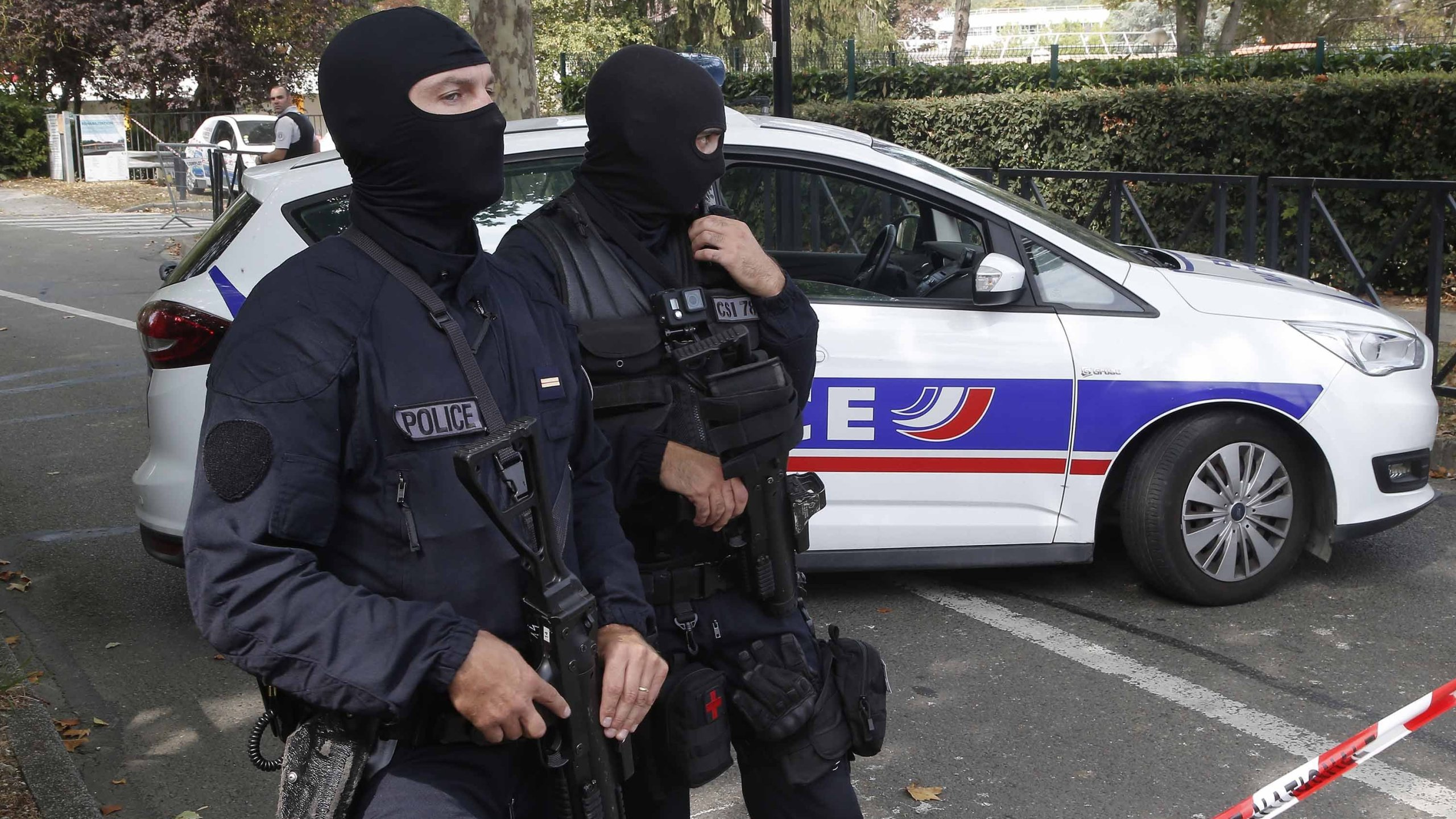 French police officers cordon off the area after a knife attack on Thursday in Trappes. (Credit: Michel Euler/AP)