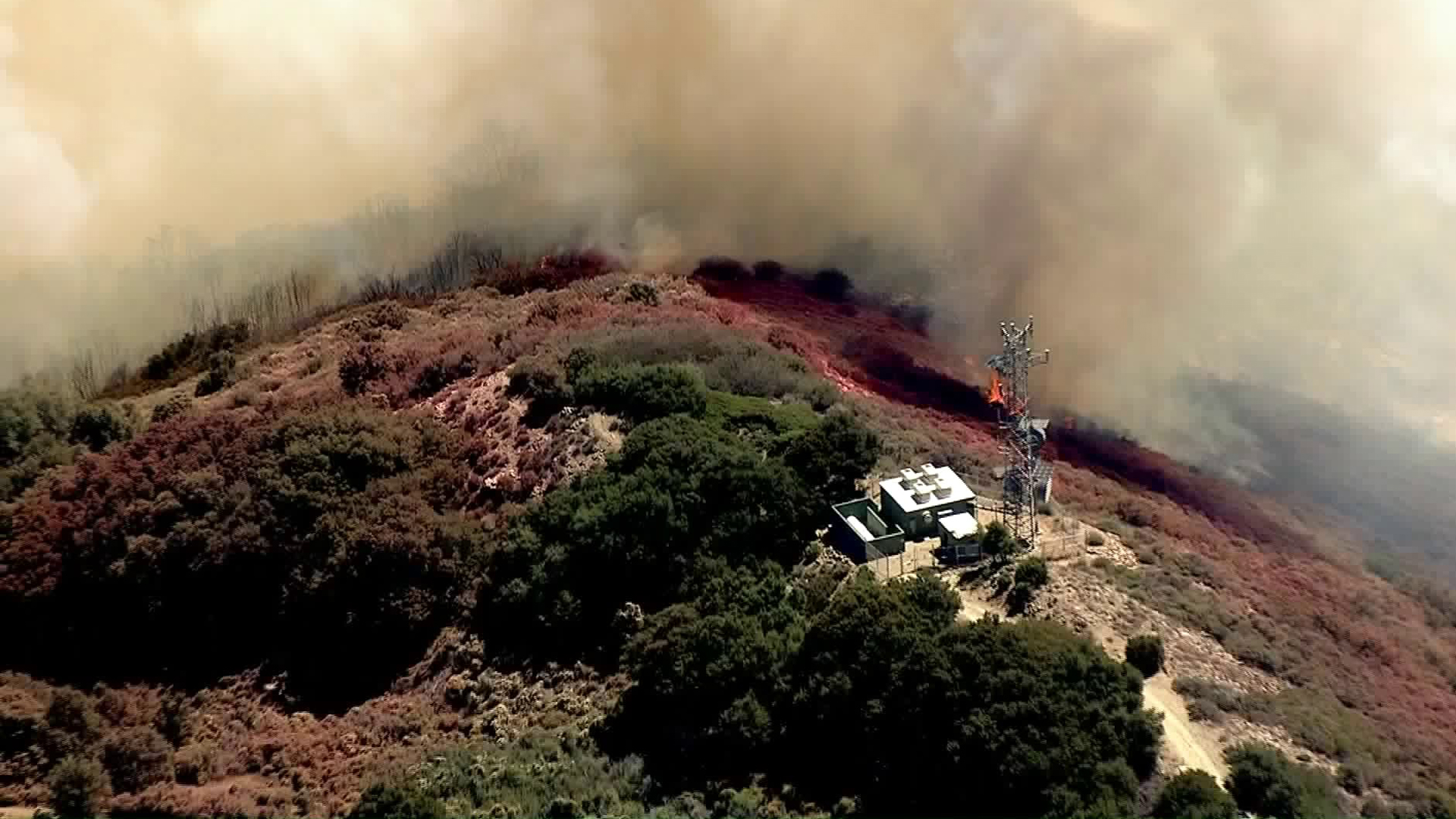 A flare-up from the Holy Fire was burning close to Santiago Peak on Aug. 27, 2018. (Credit: KTLA)