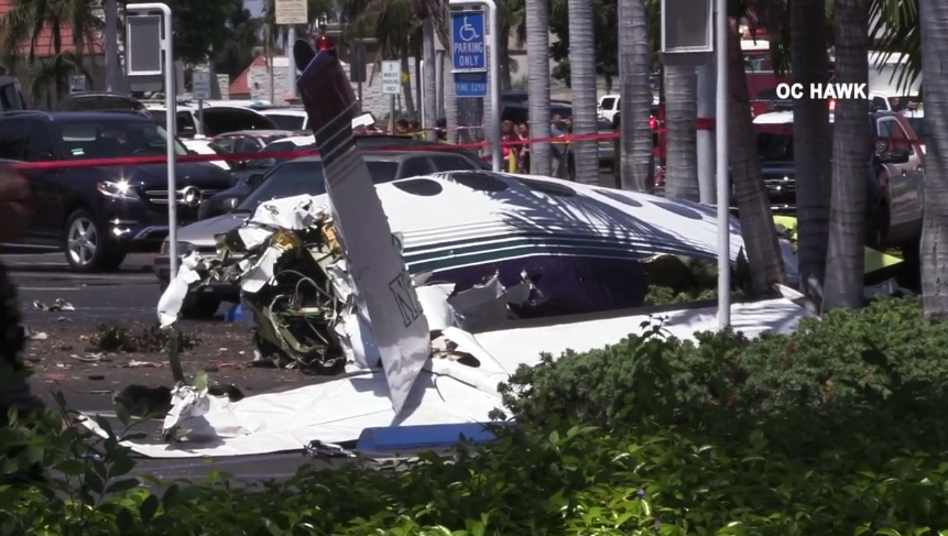 A small plane crashed at a parking lot in Santa Ana on Aug. 5, 2018. (Credit: OC Hawk)
