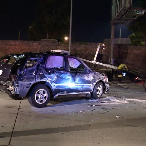 Officials respond to a crash on the northbound 5 Freeway in Anaheim on Aug. 5, 2018. (Credit: Southern Counties News)