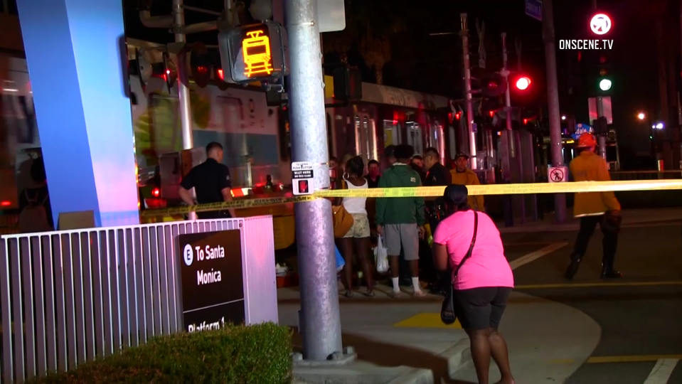 Onlookers are seen at the scene where two people died in Baldwin Hills following a car-to-car shooting on Aug. 6, 2018. (Credit: OnScene.TV)