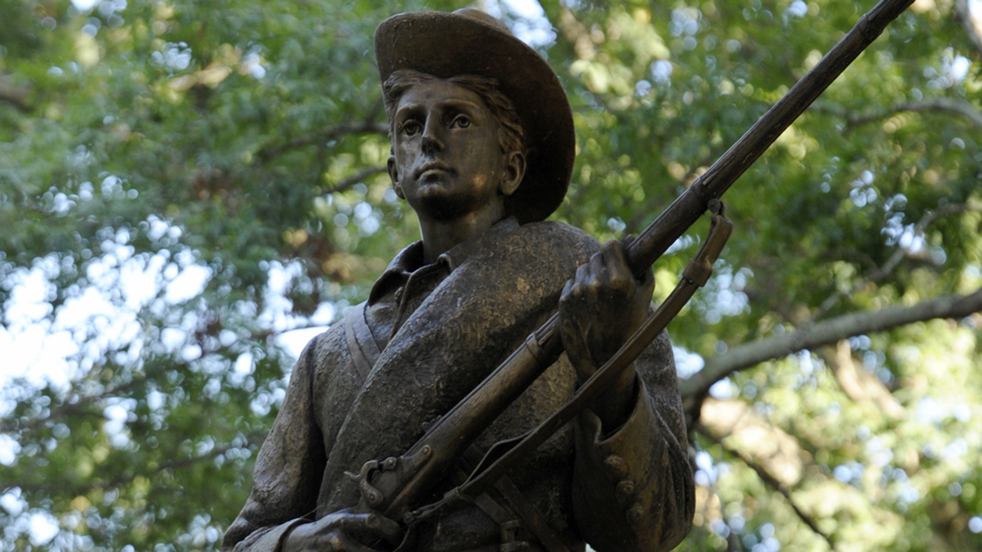 A Confederate statue, coined Silent Sam, is guarded by two layers of fence, chain and police on the campus of the University of Chapel Hill on August 22, 2017 in Chapel Hill North Carolina. (Credit: Sara D. Davis/Getty Images)