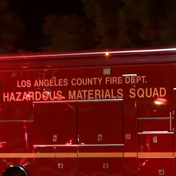 A hazmat team responds to an aerospace parts manufacturing company in Valencia on Aug. 6, 2018.