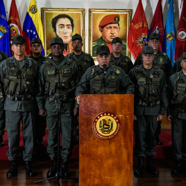 Venezuelan Defense Minister Padrino Lopez, center, flanked by the military high command, delivers a press conference in Caracas on Aug. 5, 2018. (Credit: JUAN BARRETO/AFP/Getty Images)