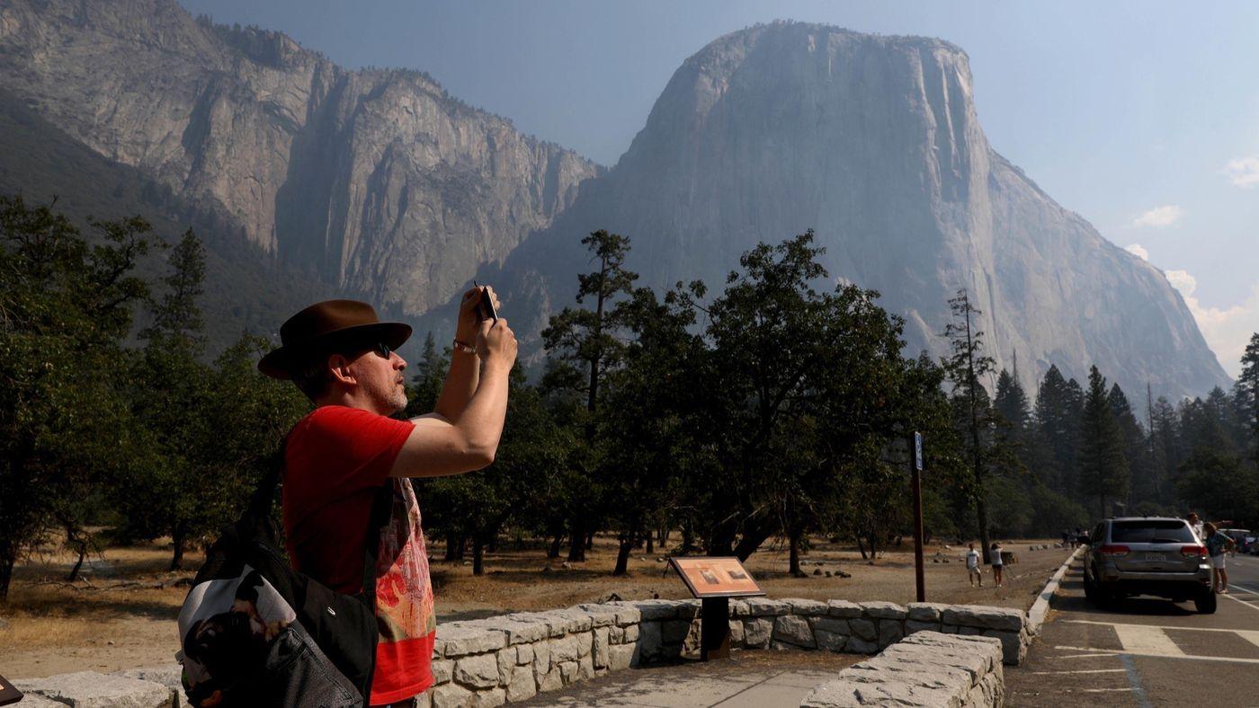 Steve Maddison of Holland photographs El Capitan upon Yosemite National Park's reopening Aug. 14, 2018. (Credit: Gary Coronado / Los Angeles Times)