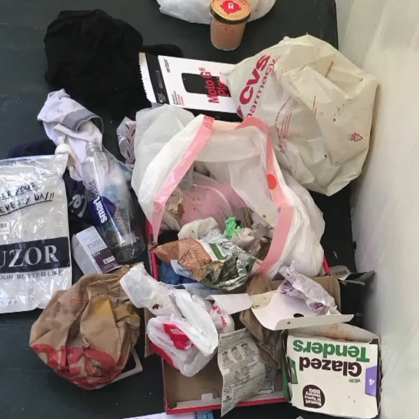 Trash is seen at a Westlake District home on Sept. 14, 2018. (Credit: KTLA)