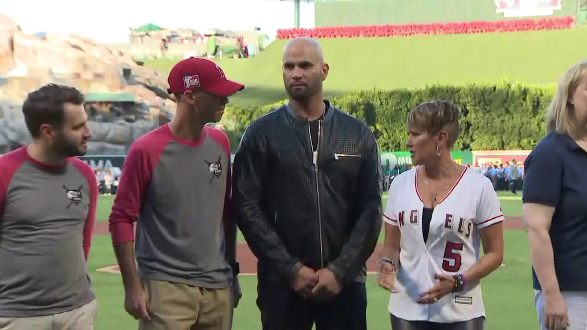 """The founders of anti-human trafficking organization """"Strike Out Slavery,"""" Los Angeles Angels Baseman Albert Pujols and his wife, Deidre, stand alongside other organizers during an event in Anaheim on Sept. 15, 2018. (Credit: KTLA)"""
