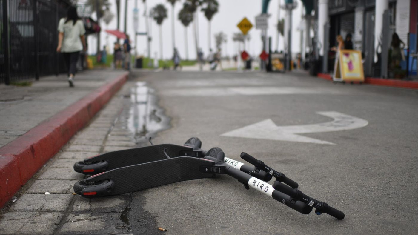 A pair of Bird scooters are seen on a street in Los Angeles in an undated photo. (Credit: Gabriel S. Scarlett / Los Angeles Times)