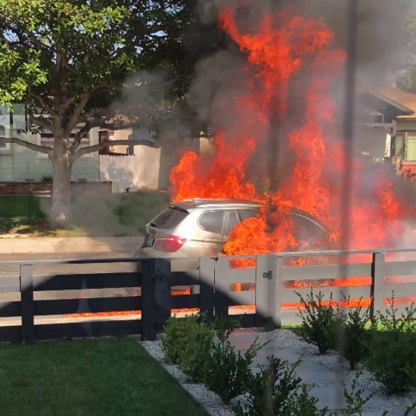 A BMW caught fire as it was parked in front of the owner's home in Westchester on Sept. 10, 2018.
