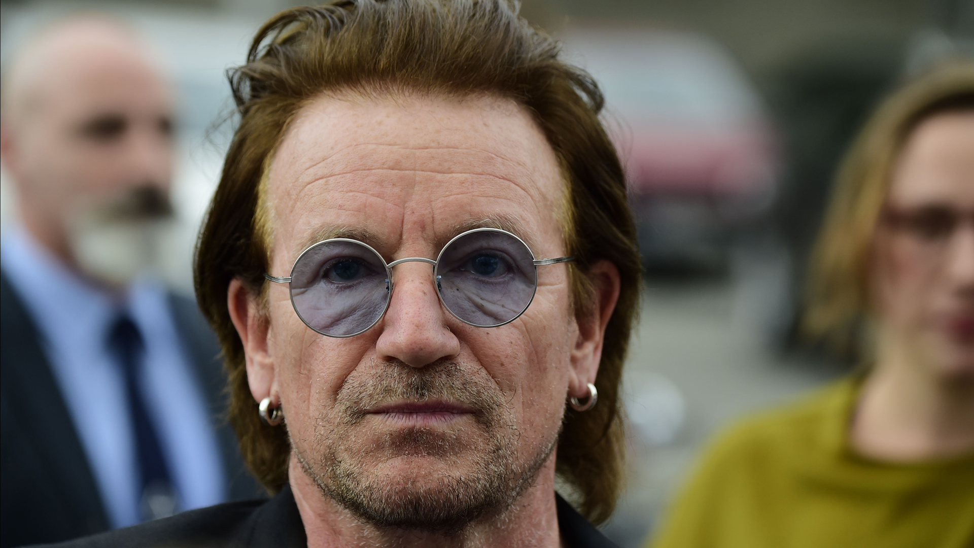 U2 lead singer Bono is pictured after a meeting with the German Chancellor in Berlin on August 28, 2017. (Credit: TOBIAS SCHWARZ/AFP/Getty Images)