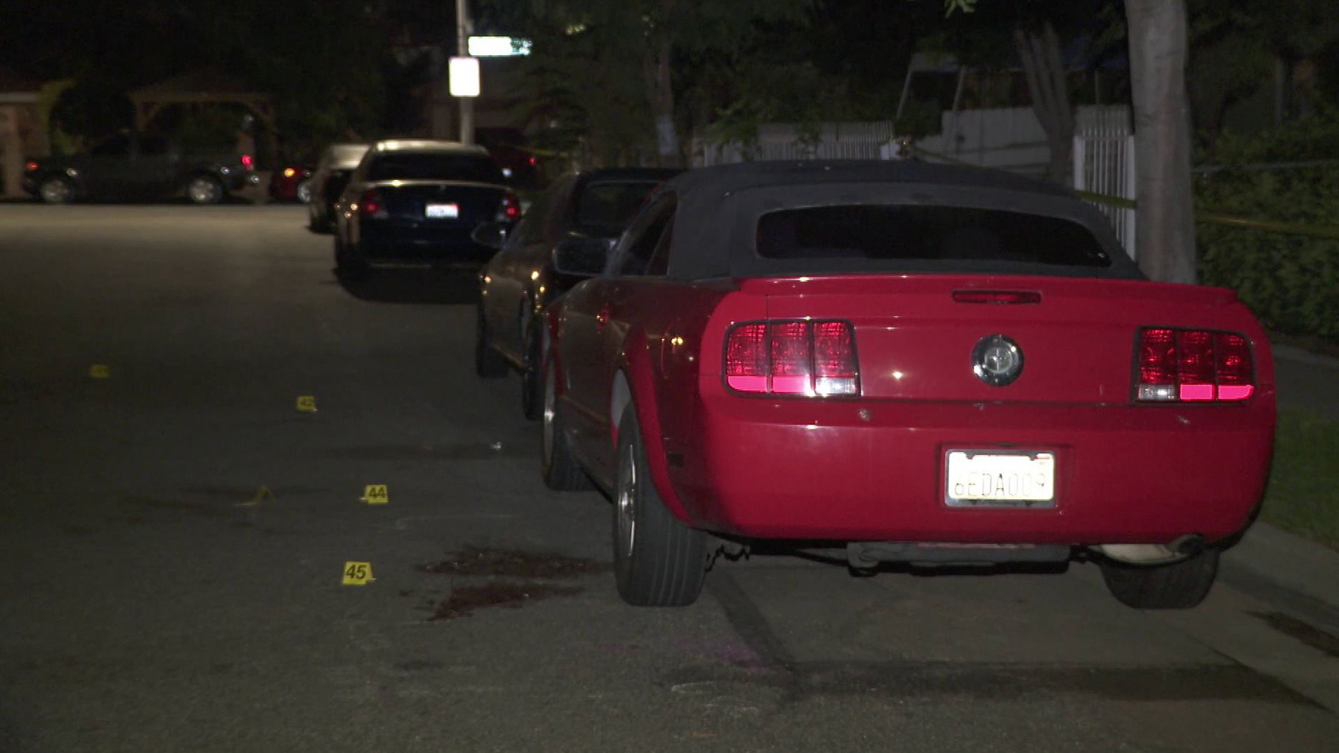 Evidence markers sit at the scene of a shooting that left four people wounded during a house party in Baldwin Park on Sept. 23, 2018.
