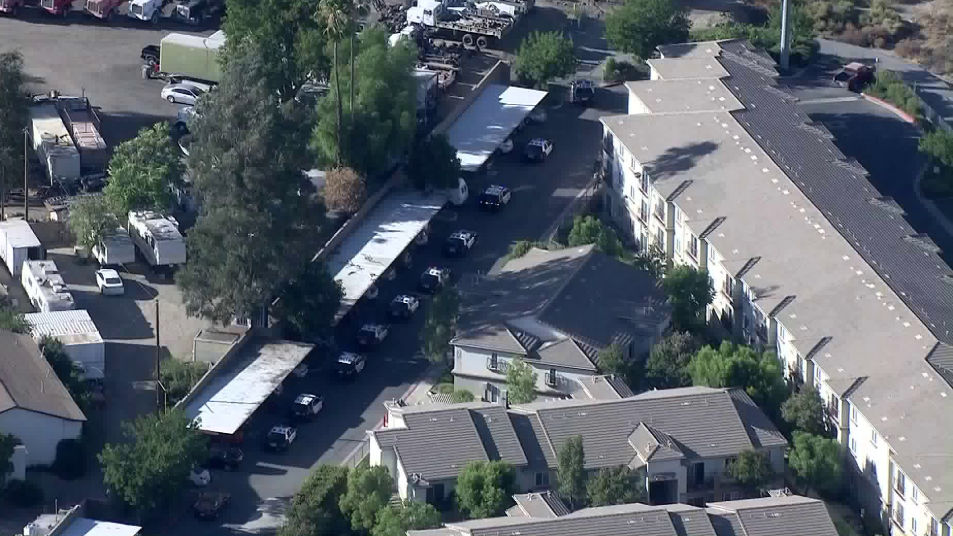 Patrol cars are seen outside a residential complex in Castaic on Sept. 14, 2018. (Credit: KTLA)