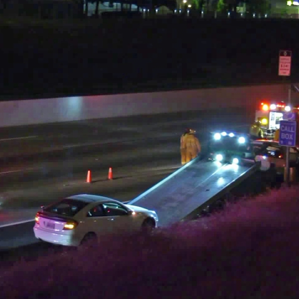 Authorities investigate a deadly hit-and-run crash on the 91 Freeway in Compton on Sept. 5, 2018. (Credit: KTLA)
