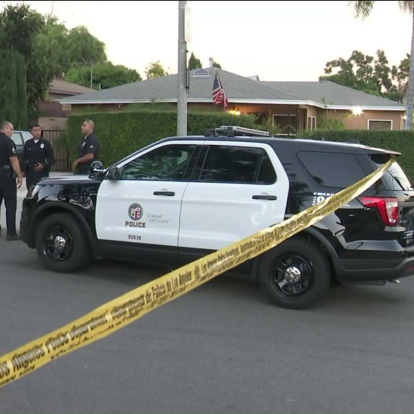 Police investigate a death at an El Sereno home on Sept. 7, 2018. (Credit: KTLA)