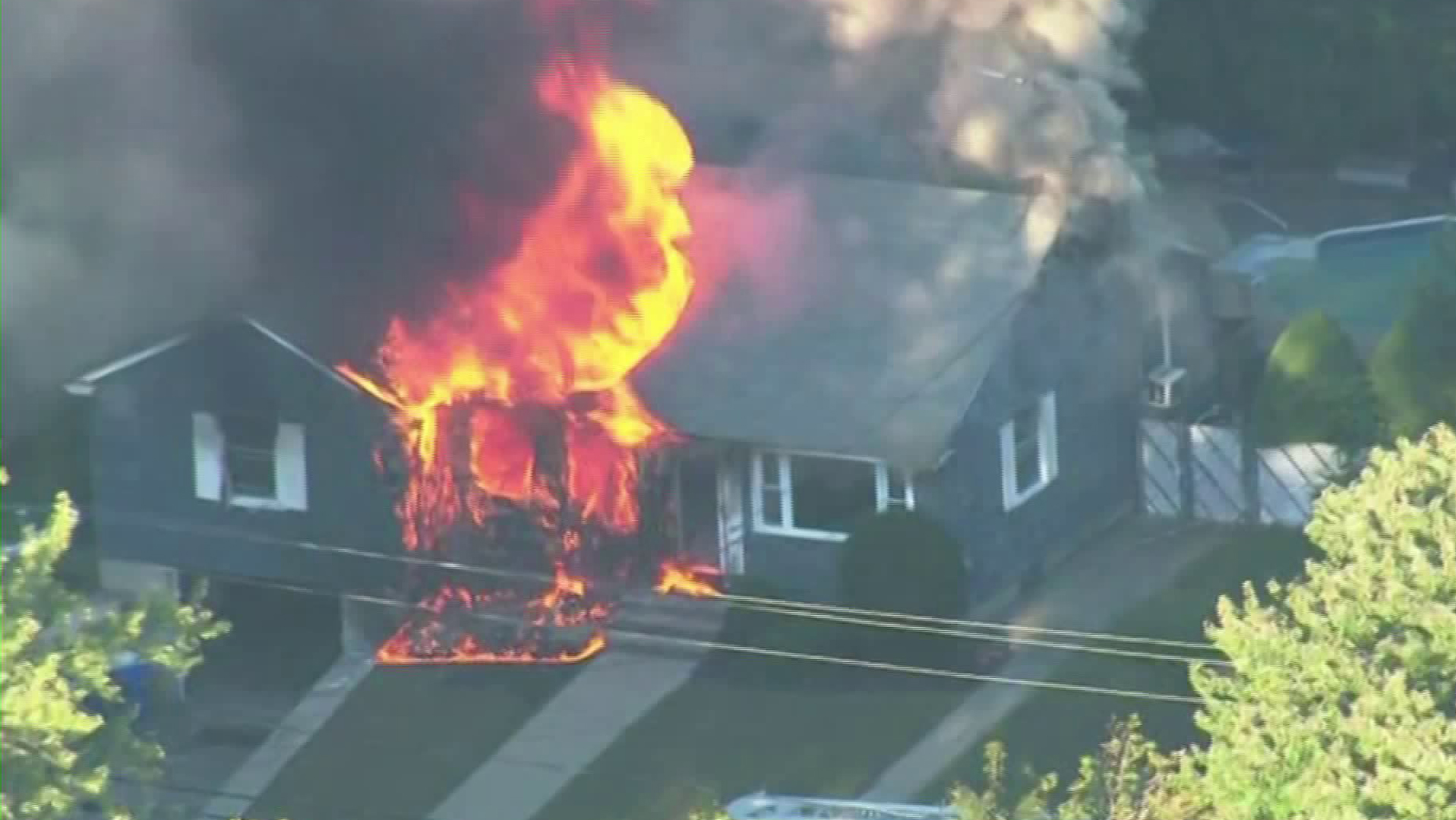 A home burned in Massachusetts after reports of suspected gas explosions on Sept. 13, 2018. (Credit: WBZ)