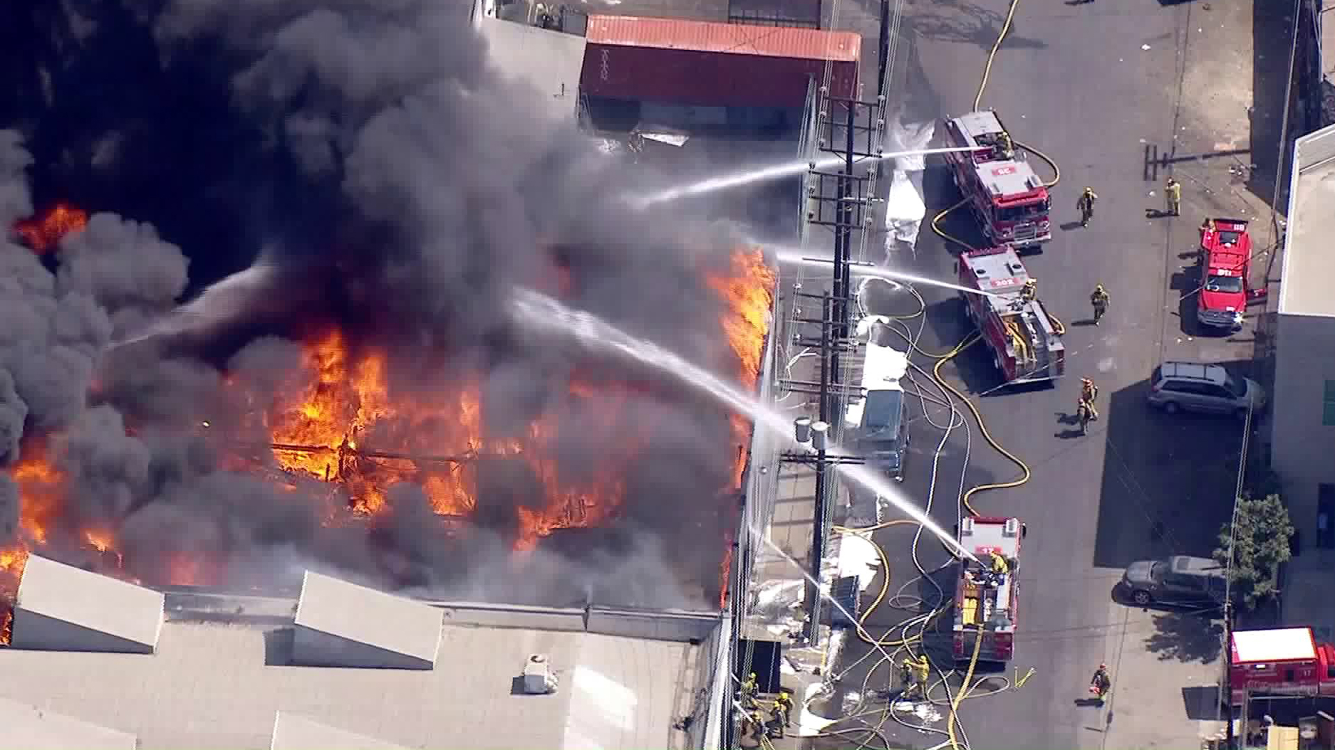 Firefighters battle a blaze at a commercial building in Boyle Heights on Sept. 19, 2018. (Credit: KTLA)