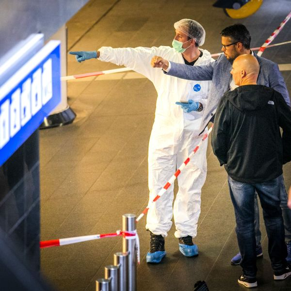 Policemen and forensics are at work after a stabbing incident at the central station in Amsterdam on Aug. 31, 2018. (Credit: REMKO DE WAAL/AFP/Getty Images)
