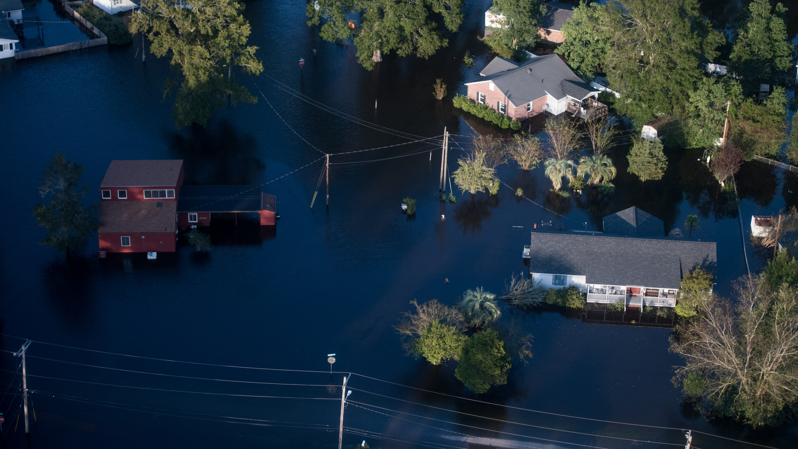 Homes are surrounded by floodwaters from Hurricane Florence on Sept. 17, 2018 in Conway, South Carolina. (Credit: Sean Rayford/Getty Images)