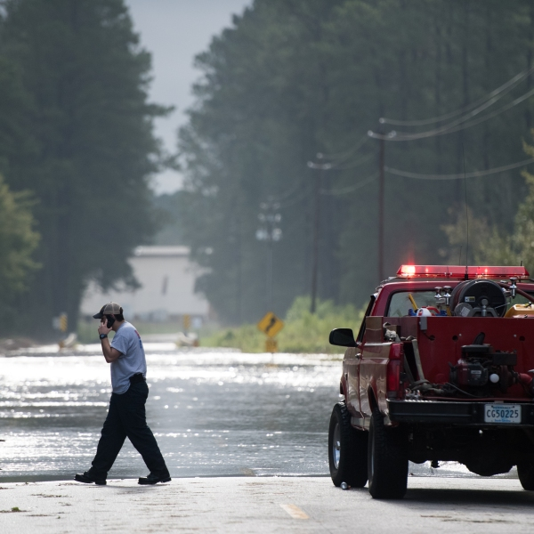 Wallace firefighter A.J. Jackson explores a flooded road after Hurricane Florence struck the Carolinas September 17, 2018, in Wallace, South Carolina. (Credit: Sean Rayford/Getty Images)