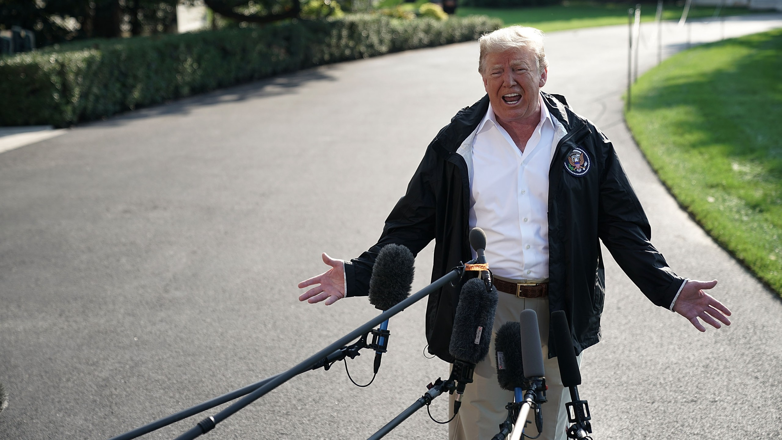 Donald Trump speaks to members of the media prior to a Marine One departure at the South Lawn of the White House on Sept. 19, 2018. (Credit: Alex Wong/Getty Images)