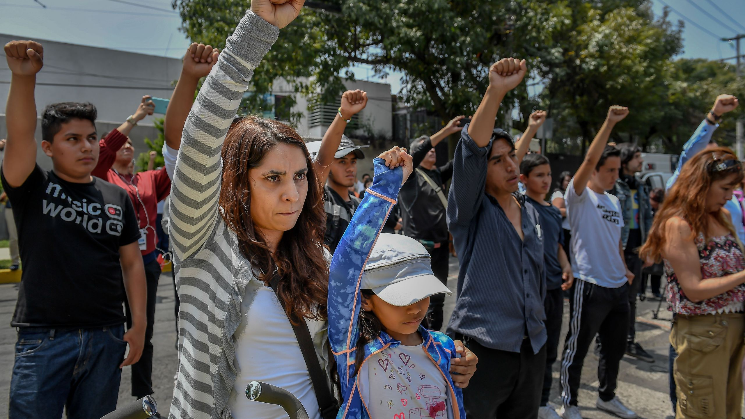 People pay homage to quake victims in Mexico City on Sept. 19, 2018, as Mexico marks the anniversaries of two deadly earthquakes that hit the country. (Credit: Omar Torres / AFP / Getty Images)