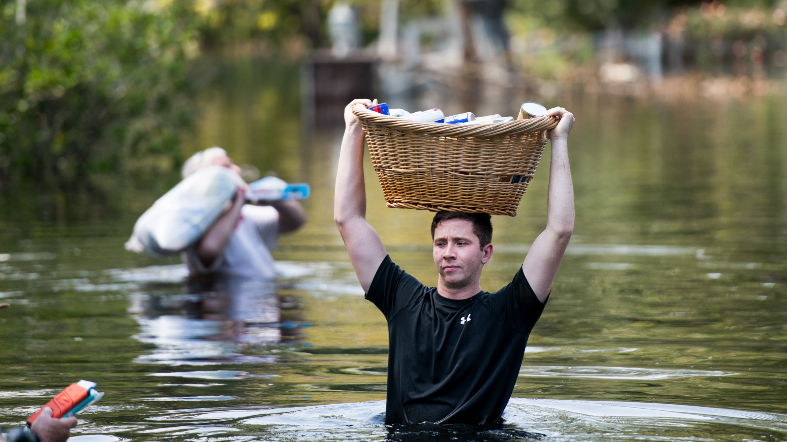 Codey Lamb walks through floodwaters caused by Hurricane Florence on Sept. 20, 2018 in Longs, South Carolina. (Credit: Sean Rayford/Getty Images)