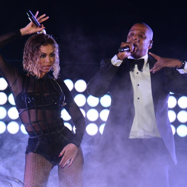 Beyonce Knowles and Jay-Z perform on stage for the 56th Grammy Awards at the Staples Center in Los Angeles on January 26, 2014. (Credit: FREDERIC J. BROWN/AFP/Getty Images)