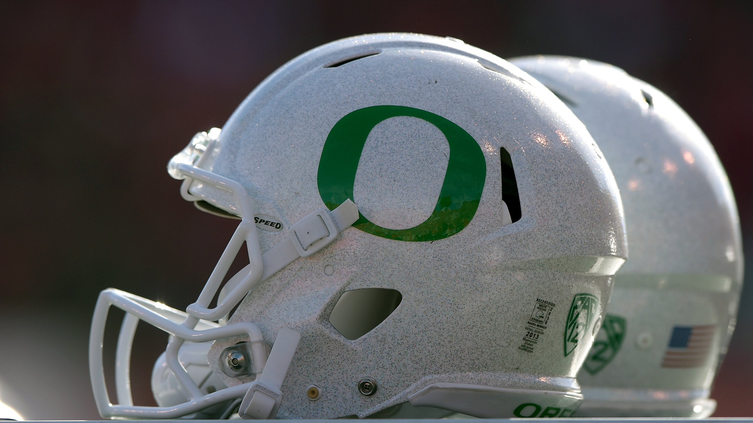 Isolated view of Oregon Ducks helmets on the sideline during the Ducks game against the Utah Utes at Rice-Eccles Stadium on November 19, 2016 in Salt Lake City, Utah. (Credit: Gene Sweeney Jr/Getty Images)