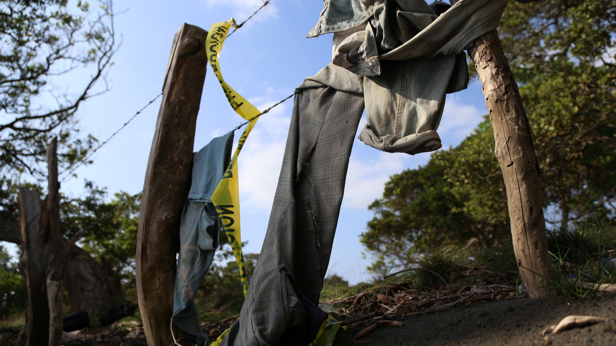Clothing is seen on March 19, 2017, around a mass grave where 12 bodies were exhumed by the Mexican authorities in Alvarado, Veracruz state. (Credit: Ilse Huesca / AFP / Getty Images)