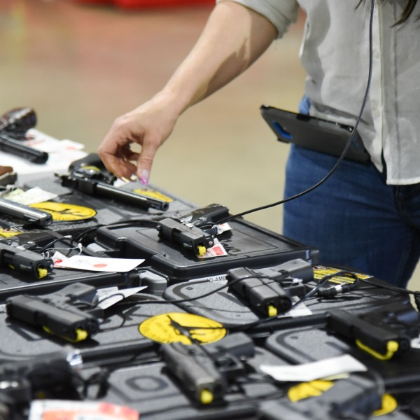 Preparations are underway February 16, 2018, for the February 17-18 South Florida Gun Show at Dade County Youth Fairgrounds in Miami. (Credit: MICHELE EVE SANDBERG/AFP/Getty Images)
