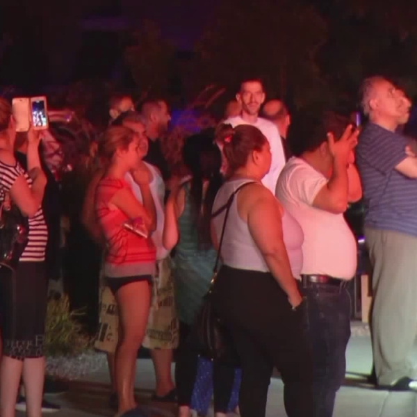 Onlookers watch an apartment fire in Glendale on Sept. 12, 2018. (Credit: Loudlabs)