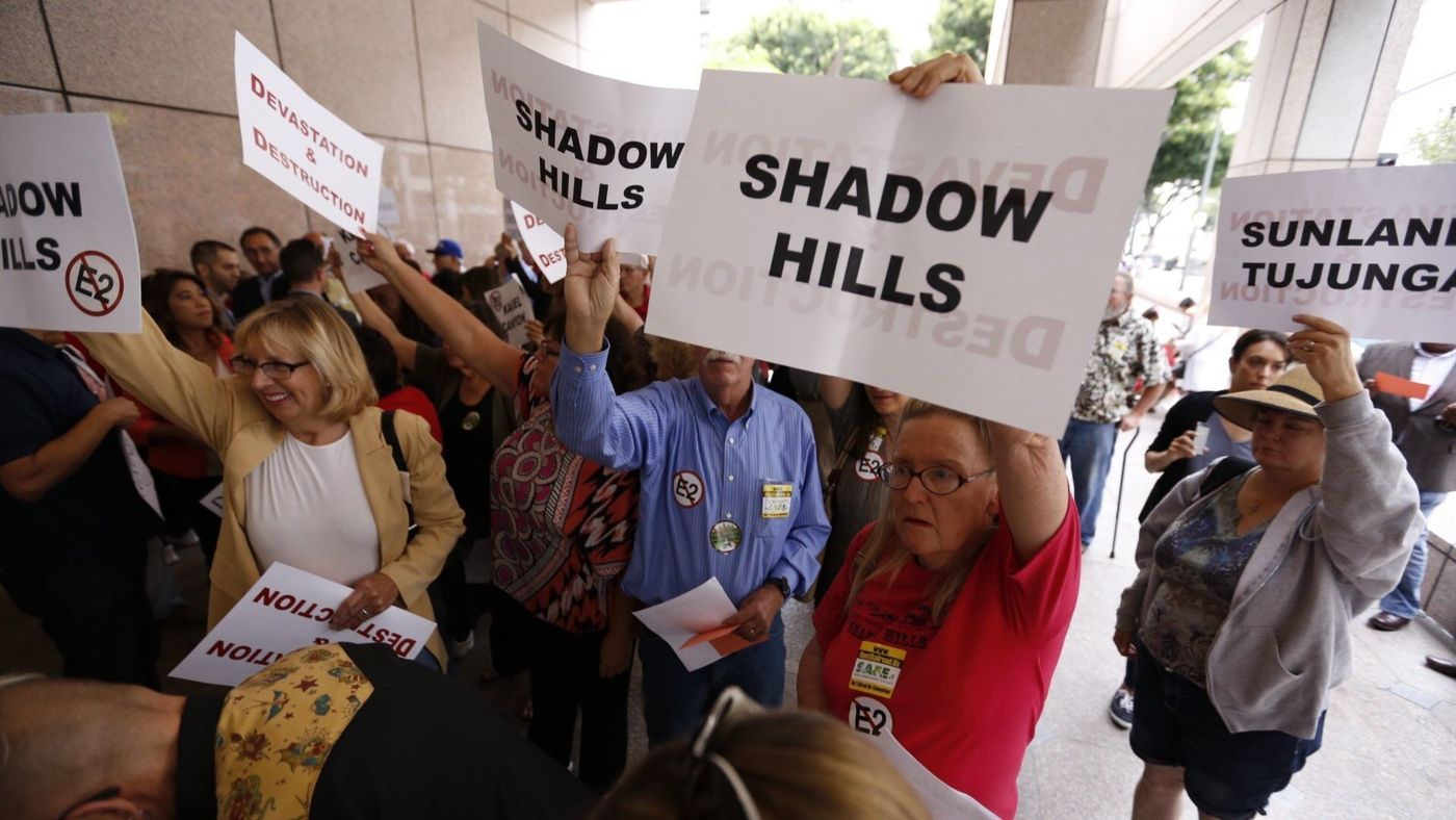 Opponents of California's high-speed rail project gather outside the Ronald Reagan State Building in downtown Los Angeles in 2015. (Credit: Al Seib / Los Angeles Times)