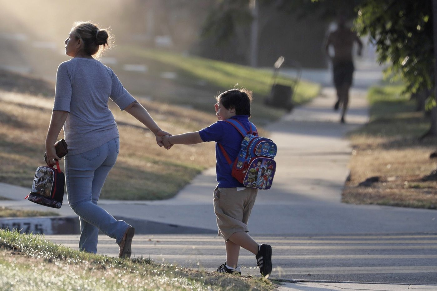 Students arrive at Baldwin Hills Elementary School on Aug. 14, 2018, for the first day of class for the Los Angeles Unified School District, the nation's second-largest school system. (Irfan Khan / Los Angeles Times)