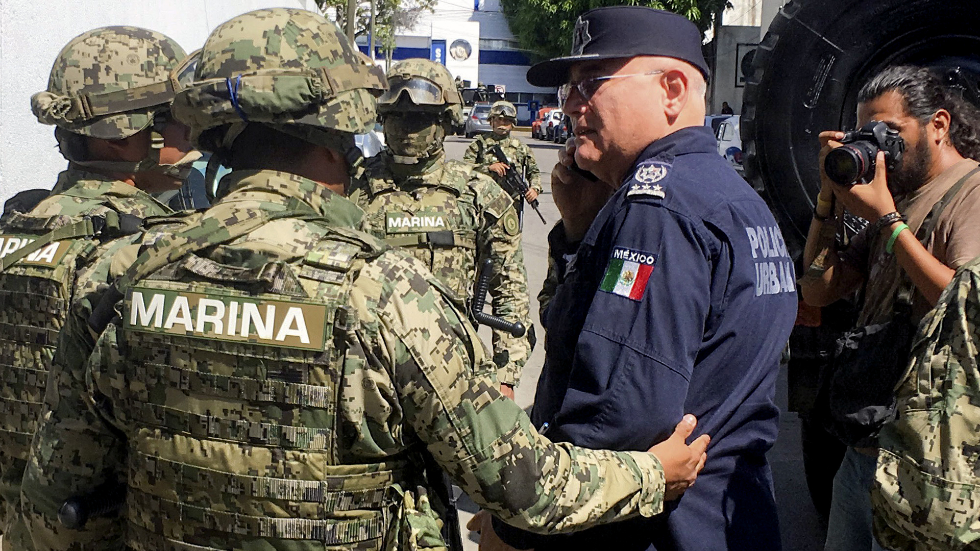 Mexican Navy members escort the Secretary of Public Security of Acapulco Max Lorenzo Sedano, right, after they took control of the local Public Security Secretariat in Acapulco, state of Guerrero, Mexico, on September 25, 2018. (Credit: FRANCISCO ROBLES/AFP/Getty Images)