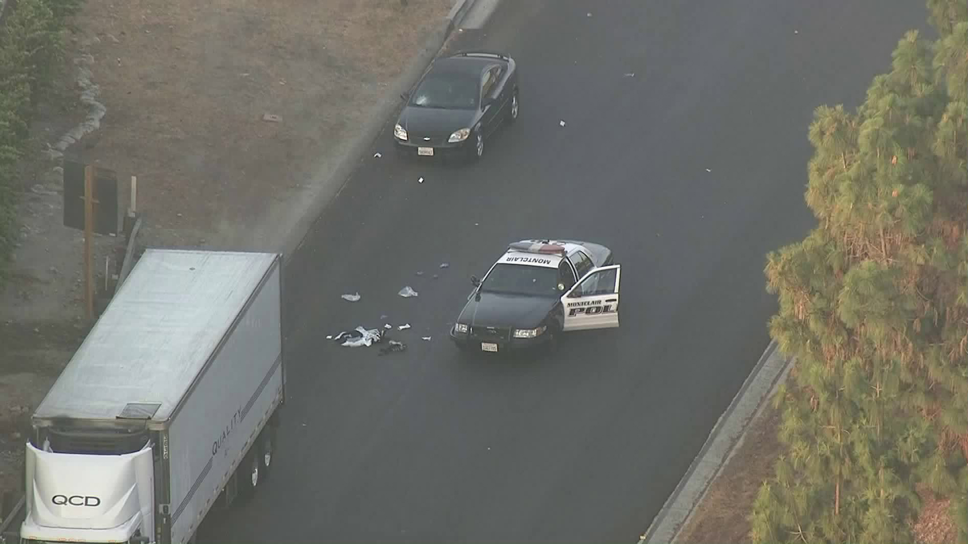 The aftermath of an officer involved shooting of a man who allegedly threw rocks at passing motorists near the 10 Freeway in Montclair is shown from Sky5 on Sept. 12, 2018. (Credit: KTLA)