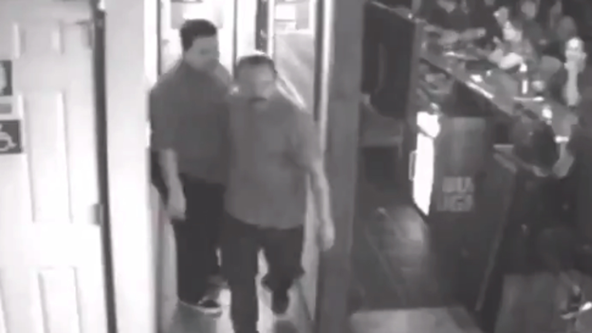 The Covina Police Department was seeking the man pictured in this surveillance camera image, center, who investigators say attacked another man with a beer mug at a Covina bar on Aug. 17, 2018, fracturing the victim's skull.