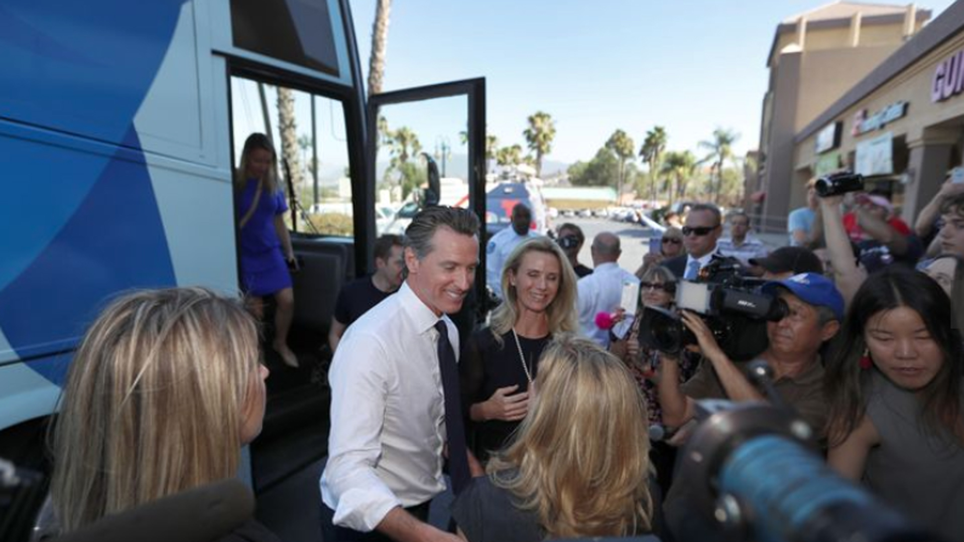 Lt. Gov. Gavin Newsom and wife Jennifer Siebel Newsom greet Assembly candidate Christy Smith, center, and congressional candidate Katie Hill in this undated photo. (Credit: Allen J. Schaben / Los Angeles Times)