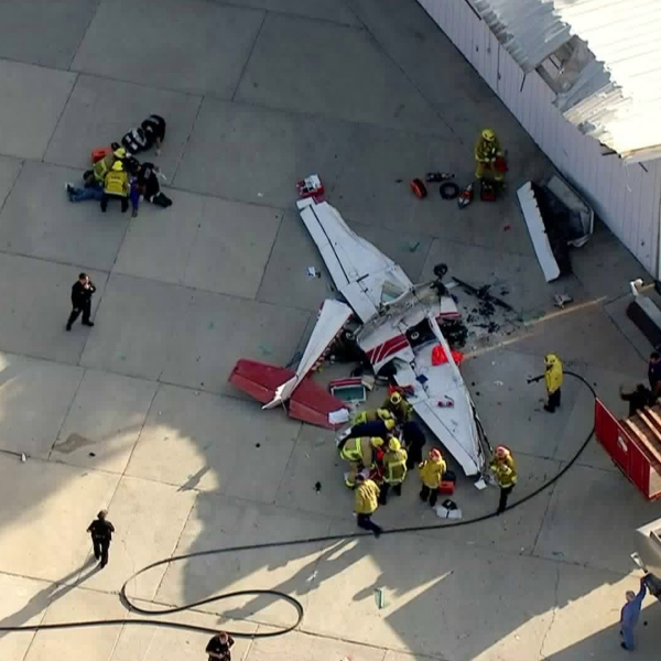 An image from Sky5 shows firefighters on the scene of a small plane crash at Whiteman Airport in Pacoima on Sept. 3, 2018. (Credit: KTLA)