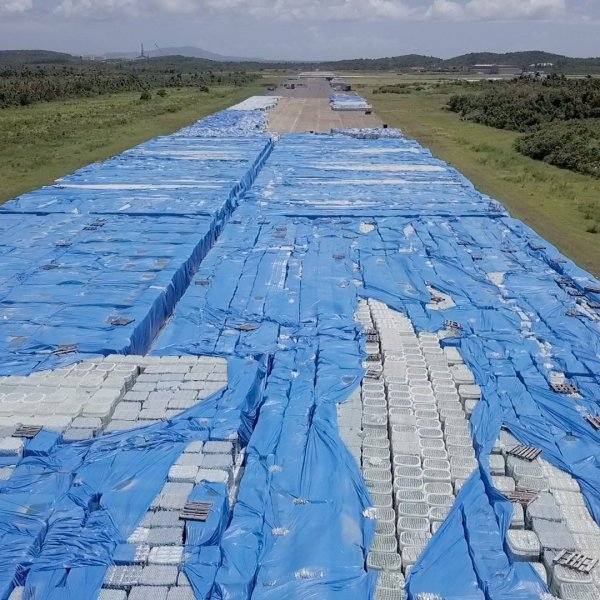 Stacks upon stacks of bottled water sit near a runway in Ceiba, Puerto Rico, on September 12, 2018. (Credit: Julian Quinones/CNN)