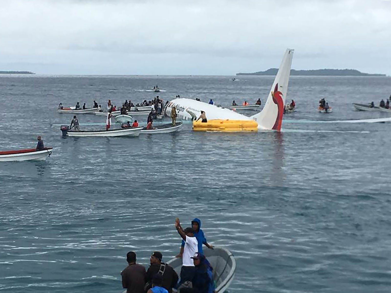 Dozens of airline passengers were forced to swim for their lives Friday after their plane missed a runway and landed in a sea lagoon on a remote island in the middle of the Pacific Ocean. (Credit: Dr. James Yaingeluo via CNN Wire)