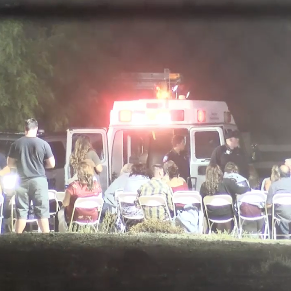 Paramedics attend to people believed to have fallen ill at a wedding in an unincorporated area of Moreno Valley on Sept. 8, 2018. (Credit: Loudlabs)