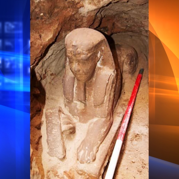 The newly uncovered sandstone statue, believed to be more than 2,000 years old, was revealed during work to lower the groundwater level in an ancient temple under excavation. (Credit: Supreme Council of Antiquities)