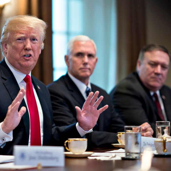 Defense Secretary James Mattis, far right, Secretary of State Mike Pompeo, second right, and Vice President Mike Pence, seated next to President Trump, have all denied writing an anonymous op-ed in the New York Times. They are seen in this file photo from May 17, 2018. (Credit: Andrew Harrer-Pool/Getty Images)
