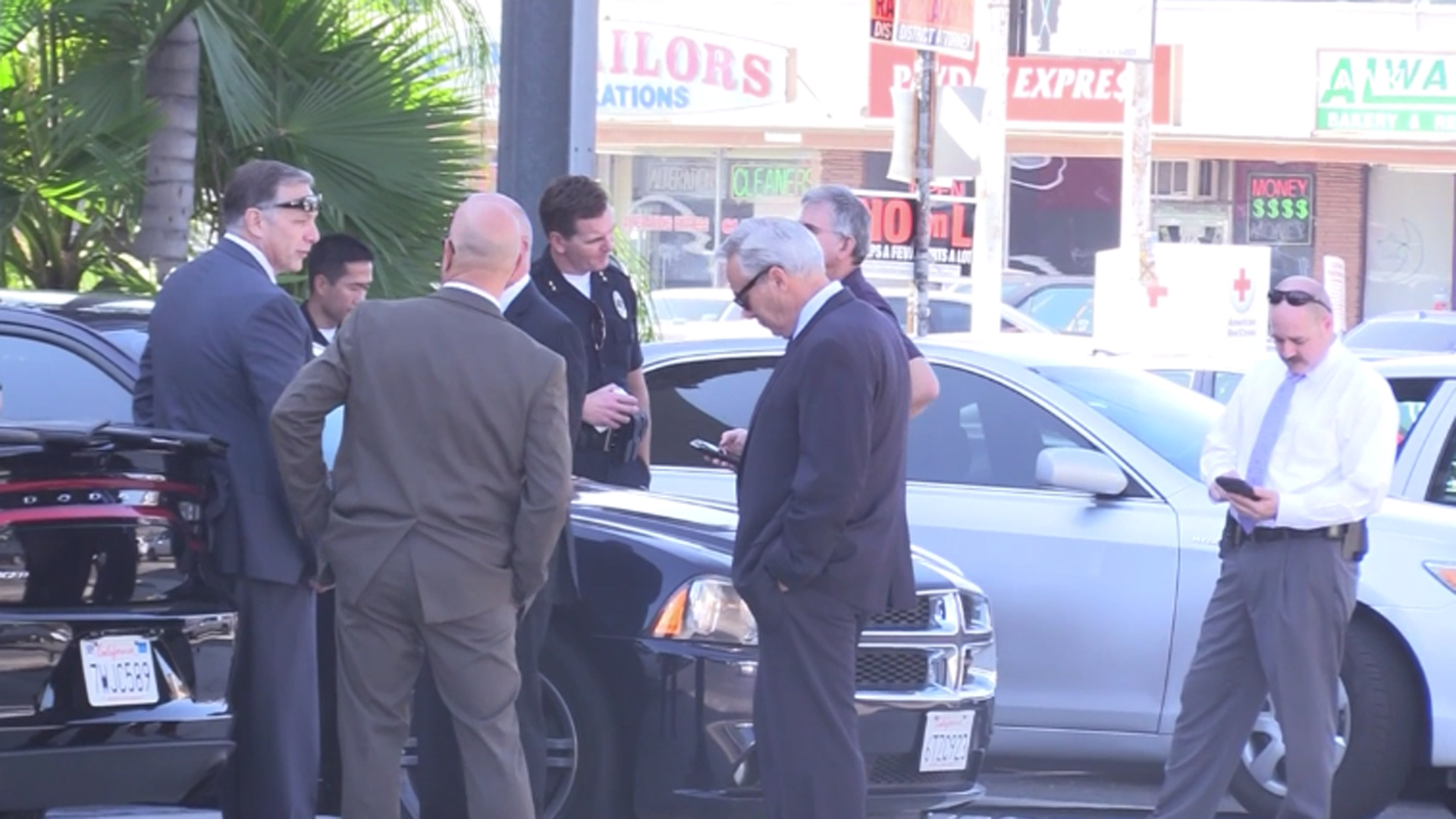 Investigators are seen in Anaheim after an incident left an assault suspect going into full cardiac arrest and two police officers seriously injured on Oct. 27, 2018. (Credit: OC Hawk)