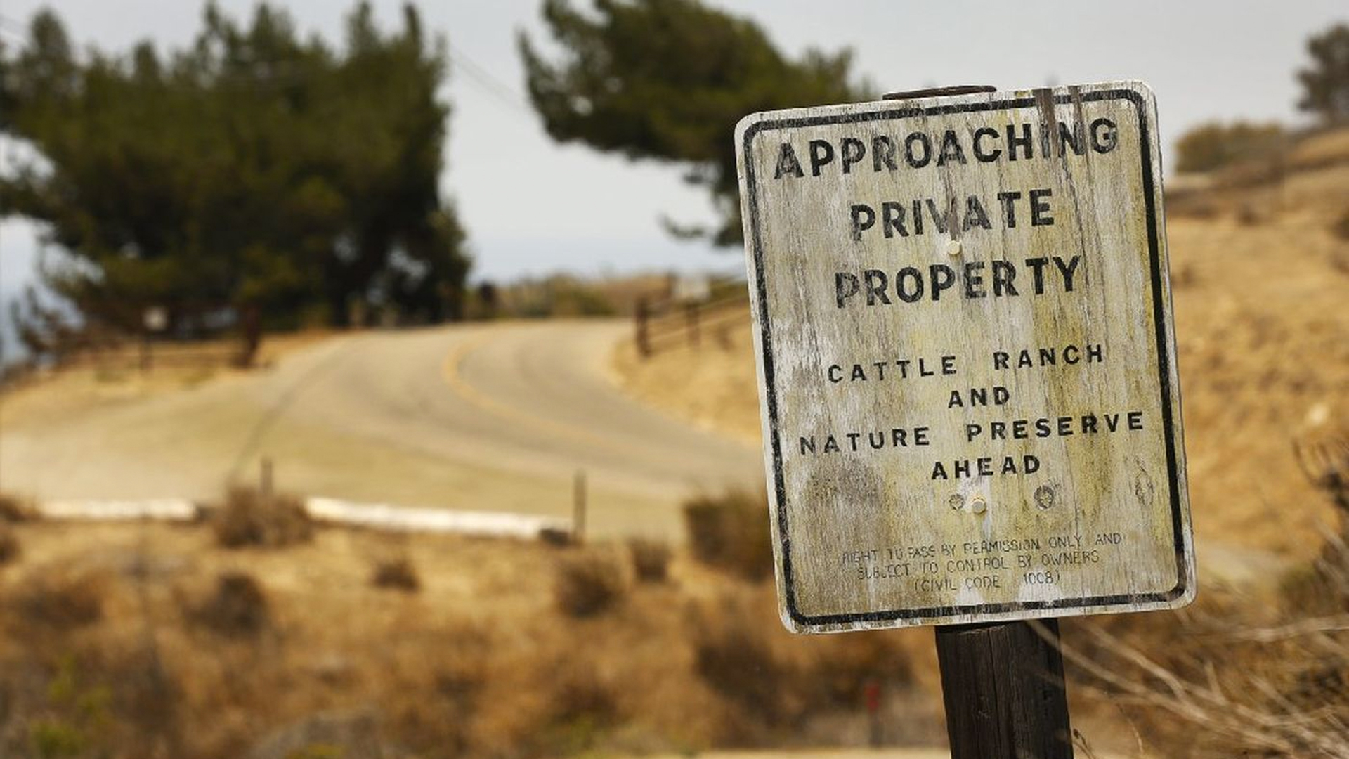 Signs warn of trespassing at Hollister Ranch Road. Mounting public outrage has fueled multiple new efforts by state officials to open a coveted stretch of California coastline. (Credit: Al Seib / Los Angeles Times)