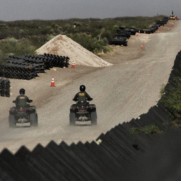 In this file photo, U.S. Border Patrol agents ride their ATV's along a stretch of the U.S.-Mexico border on April 17, 2018. (Credit: HERIKA MARTINEZ/AFP/Getty Images)